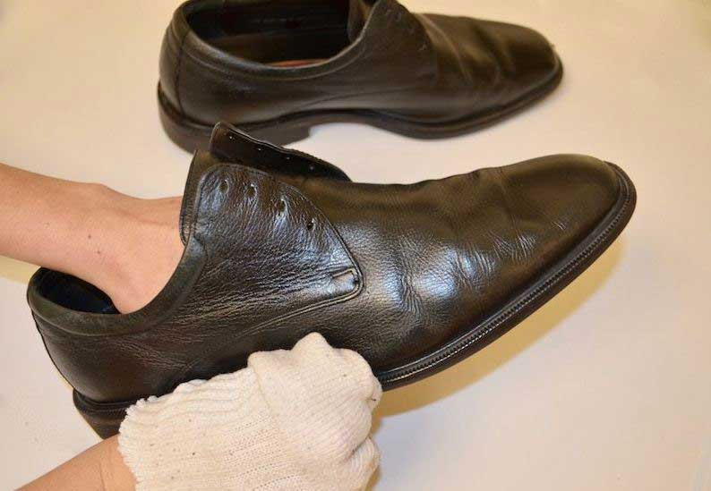 shoes wipe with dampened cloth